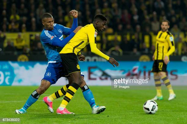 Walace of Hamburg and Ousmane Dembele of Dortmund battle for the ball during the Bundesliga match between Borussia Dortmund and Hamburger SV at...