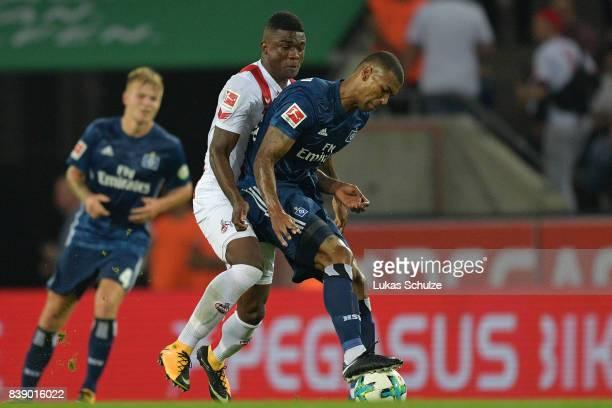 Walace of Hamburg fight for the ball with Jhon Cordoba of Koeln during the Bundesliga match between 1 FC Koeln and Hamburger SV at...