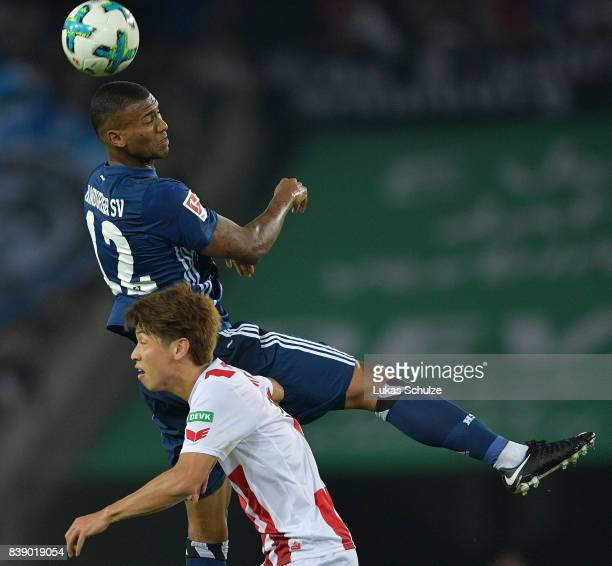 Walace of Hamburg fight for the ball with Yuya Osako of Koeln during the Bundesliga match between 1 FC Koeln and Hamburger SV at RheinEnergieStadion...