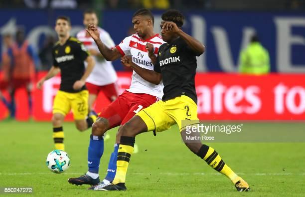 Walace of Hamburg fights for the ball with DanAxel Zagadou of Dortmund during the Bundesliga match between Hamburger SV and Borussia Dortmund at...