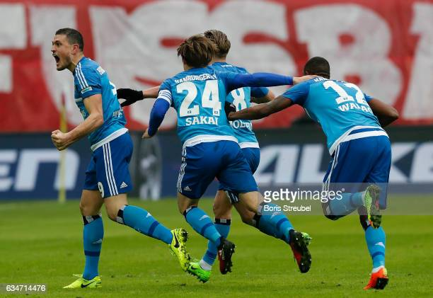 Walace of Hamburger SV celebrates with team mates after scoring his team's second goal during the Bundesliga match between RB Leipzig and Hamburger...