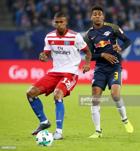 Walace Souza Silva of Hamburg and Bernardo of Leipzig battle for the ball during the Bundesliga match between Hamburger SV and RB Leipzig at...