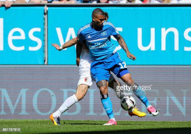 Walace Souza Silva of Hamburg and Halil Altintop of Augsburg battle for the ball during the Bundesliga match between FC Augsburg and Hamburger SV at...