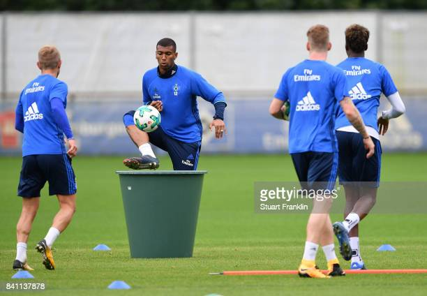 Walace trys to chip the ball into a water bin during a training session of Hamburger SV on August 31 2017 in Hamburg Germany