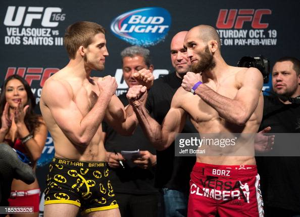 TJ Waldburger and Adlan Amagov face off during the UFC 166 weighin at the Toyota Center on October 18 2013 in Houston Texas