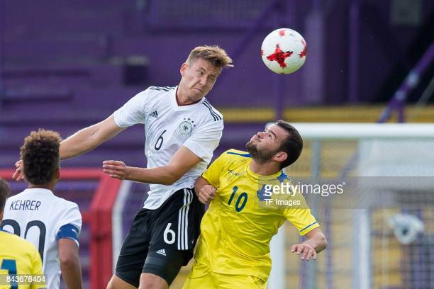 Waldemar Anton of Germany und Ardit Gashi of Kosovo battle for the ball during the U21 UEFA 2018 EM Qualifying match between Germany and Kosovo at...