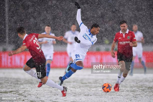 Waldemar Anton of Hannover 96 and Adam Szalai of 1899 Hoffenheim battle for the ball during a heavy snow storm during the Bundesliga match between...
