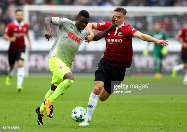 Waldemar Anton of Hannover and Copete Cordoba of Koeln battle for the ball during the Bundesliga match between Hannover 96 and 1 FC Koeln at HDIArena...