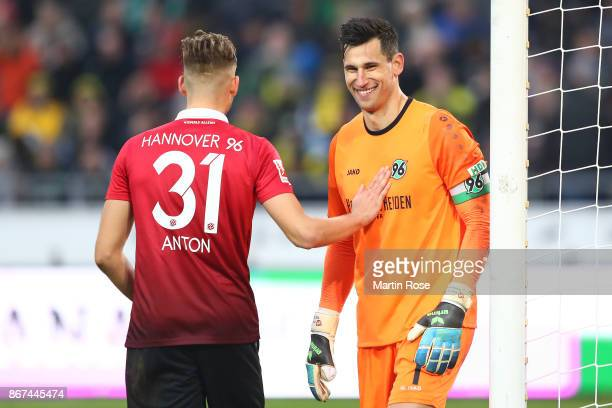 Waldemar Anton of Hannover and goalkeeper Philipp Tschauner of Hannover smile during the Bundesliga match between Hannover 96 and Borussia Dortmund...