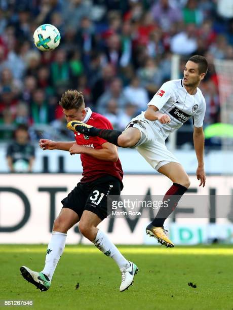 Waldemar Anton of Hannover and Mijat Gacinovic of Frankfurt battle for the ball during the Bundesliga match between Hannover 96 and Eintracht...
