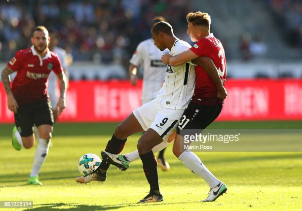 Waldemar Anton of Hannover and of Frankfurt battle for the ball during the BundesligaSebastien Haller match between Hannover 96 and Eintracht...