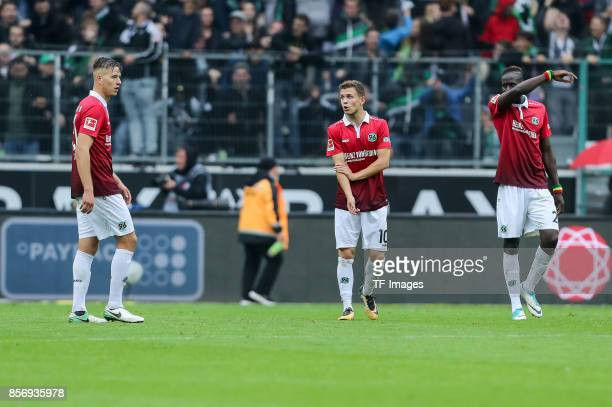 Waldemar Anton of Hannover and Sebastian MaierSalif Sane of Hannover looks dejected during the Bundesliga match between Borussia Moenchengladbach and...