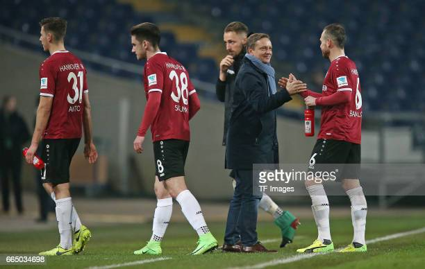 Waldemar Anton of Hannover and Valmir Sulejmani of Hannover and Florian Huebner of Hannover shakes hands with Horst Heldt of Hannover and Marvin...