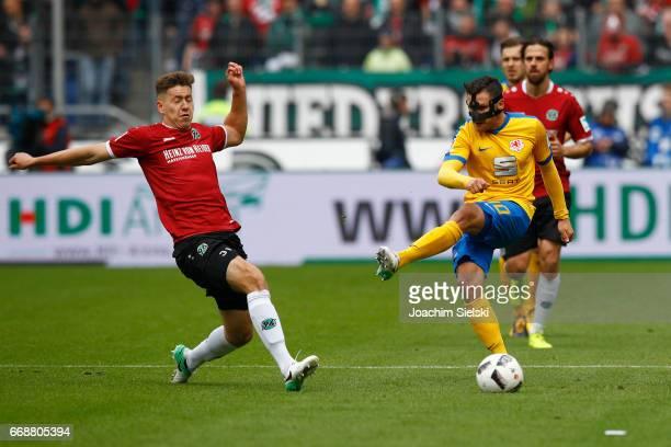 Waldemar Anton of Hannover challenges Mirko Boland of Braunschweig during the Second Bundesliga match between Hannover 96 and Eintracht Braunschweig...