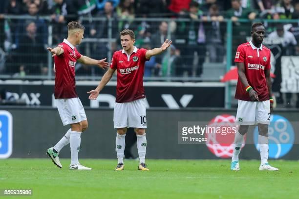 Waldemar Anton of Hannover Sebastian MaierSalif Sane of Hannover looks dejected during the Bundesliga match between Borussia Moenchengladbach and...
