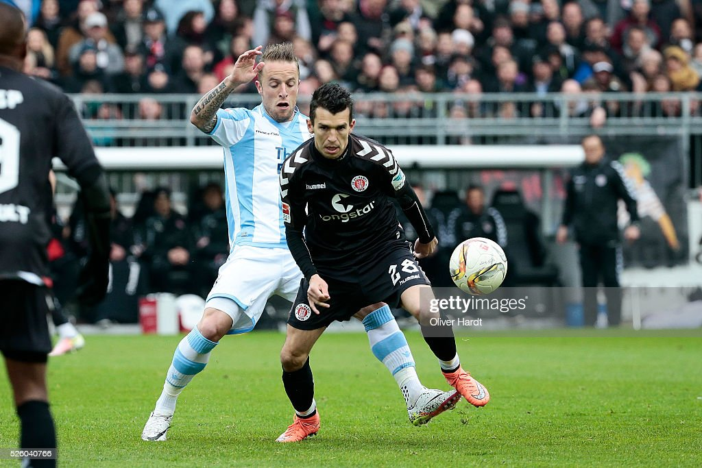 Waldemar Sobota (R) of Hamburg and Daniel Adlung (L) of Muenchen compete for the ball during the Second Bundesliga match between FC St. Pauli and 1860 Muenchen at Millerntor Stadium on April 29, 2016 in Hamburg, Germany.