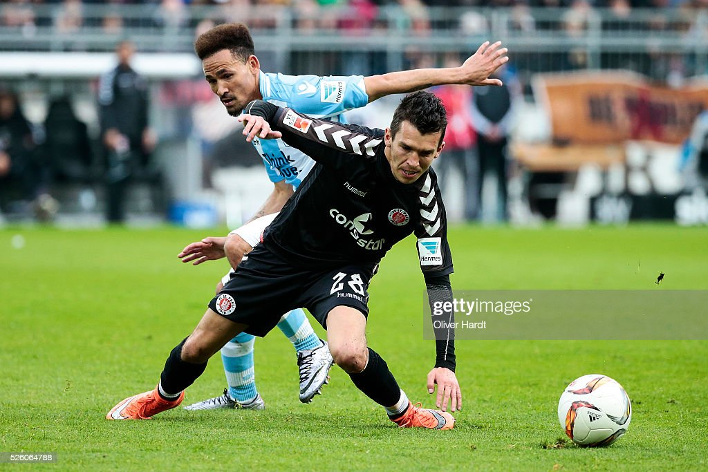 Waldemar Sobota (R) of Hamburg and Dayton Claasen (L) of Muenchen compete for the ball during the Second Bundesliga match between FC St. Pauli and 1860 Muenchen at Millerntor Stadium on April 29, 2016 in Hamburg, Germany.