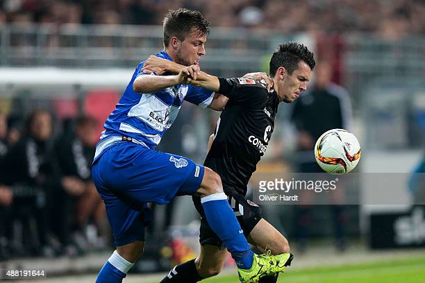 Waldemar Sobota of Pauli and Kevin Wolze of Duisburg compete for the ball during the Second Bundesliga match between FC St Pauli and MSV Duisburg at...