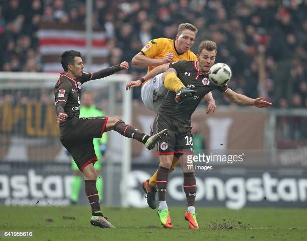 Waldemar Sobota of St Pauli and Marco Hartmann of Dynamo Dresden and Lennart Thy of St Pauli battle for the ball during the Second Bundesliga match...