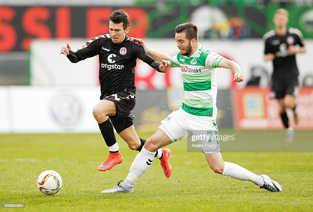 Waldemar Sobota of St Pauli is tackled by Niko Giesselmann of Greuther Furth before the 2. Bundesliga match between Greuther Fuerth and FC St. Pauli at Stadion am Laubenweg on February 7, 2016 in Fuerth, Germany.