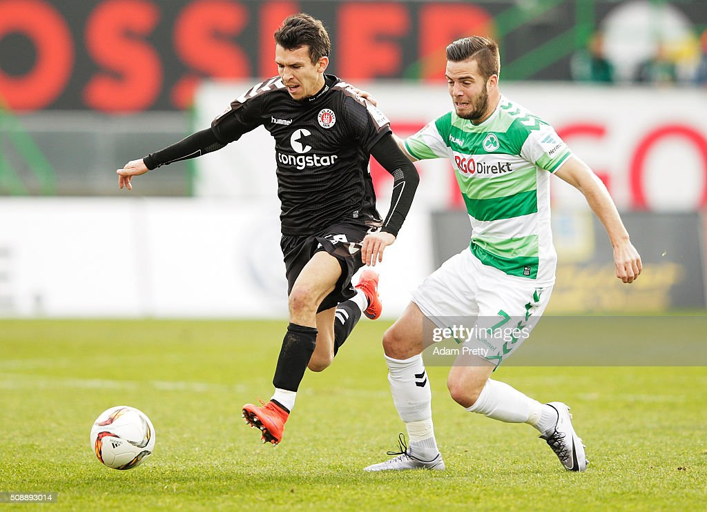 Waldemar Sobota of St Pauli is tackled by Niko Giesselmann of Greuther Furth during the 2. Bundesliga match between Greuther Fuerth and FC St. Pauli at Stadion am Laubenweg on February 7, 2016 in Fuerth, Germany.