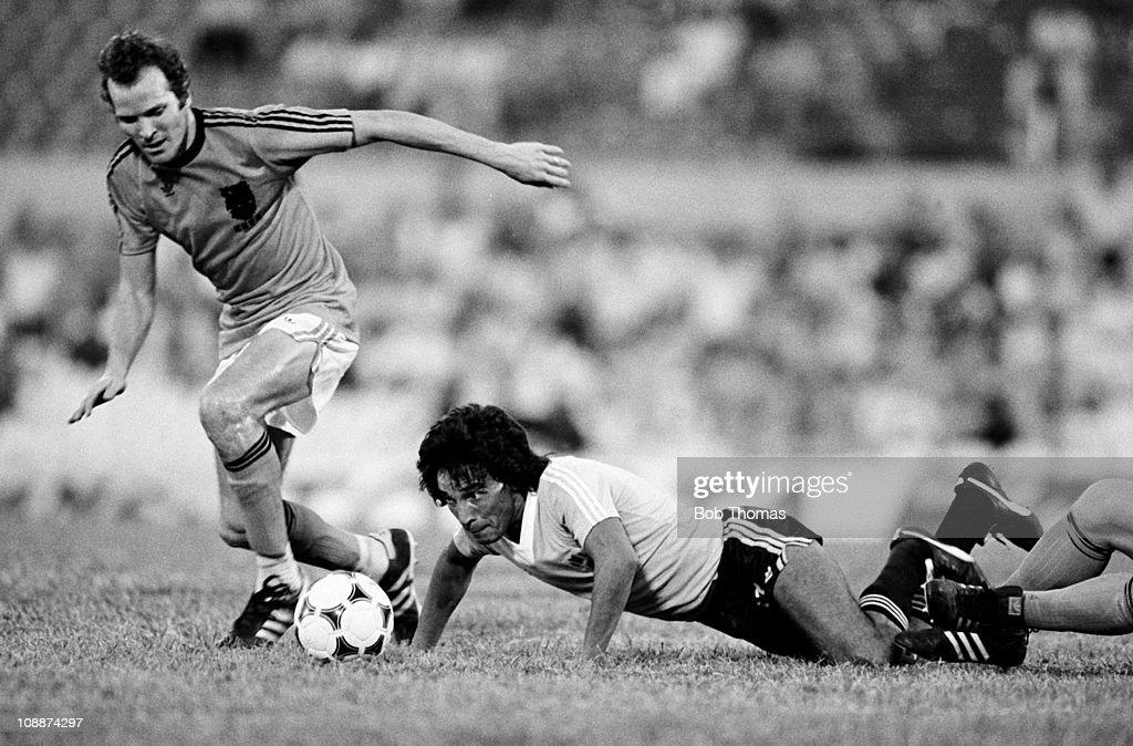 Waldemar Victorino of Uruguay keeps a close eye on the ball after a challenge by Willy Van Der Kerkhof of Holland in the Copa De Oro at the...