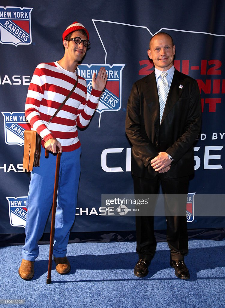 'Waldo' and Adam Graves attend the New York Rangers home opener at Madison Square Garden on October 27, 2011 in New York City.