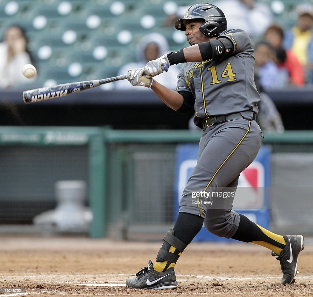 Waldyvan Estrada #14 of Alabama State connects in the fifth inning for a grand slam home run against Southern during the 2013 Urban Invitational, February 23, 2013 in Houston, Texas.