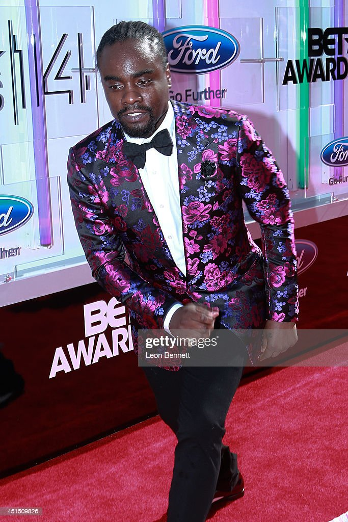 <a gi-track='captionPersonalityLinkClicked' href=/galleries/search?phrase=Wale+-+Rapper&family=editorial&specificpeople=8770277 ng-click='$event.stopPropagation()'>Wale</a> arrived at the BET & Make A Wish Foundation Recipient Wish To Attend BET Awards Red Carpet Arrivals on June 29, 2014 in Los Angeles, California.