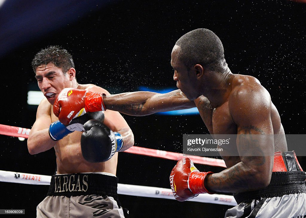 Wale 'Lucky Boy' Omotoso (R) throws a punch against Jessie Vargas during their WBC continental americas welterweight title boxing match at The Home Depot Center on March 16, 2013 in Carson, California. Vargas won with a unanimous decision.