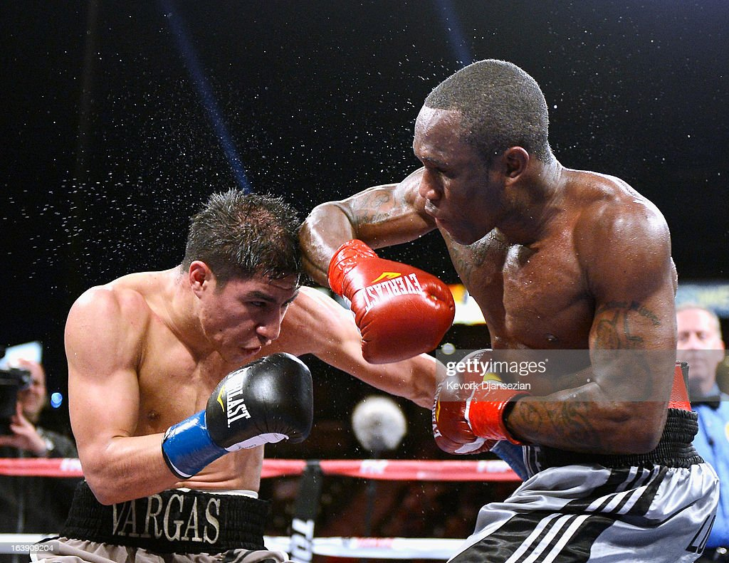 Wale 'Lucky Boy' Omotoso (R) throws throws an elbow against Jessie Vargas during their WBC continental americas welterweight title boxing match at The Home Depot Center on March 16, 2013 in Carson, California. Vargas won with a unanimous decision.
