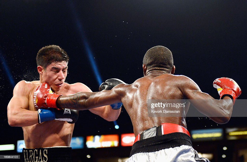 Wale Omotoso (R) throws a punch against Jessie Vargas during their WBC Continental Americas Welterweight Championship boxing match at The Home Depot Center on March 16, 2013 in Carson, California.