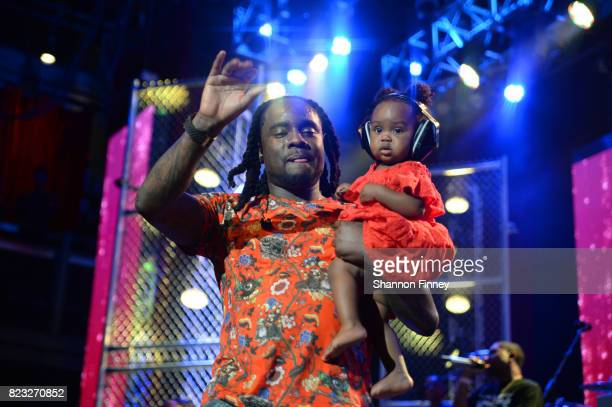 Wale performs onstage with his daughter at the BETX On The Road DMV Concert at The Fillmore Silver Spring on July 26 2017 in Silver Spring Maryland