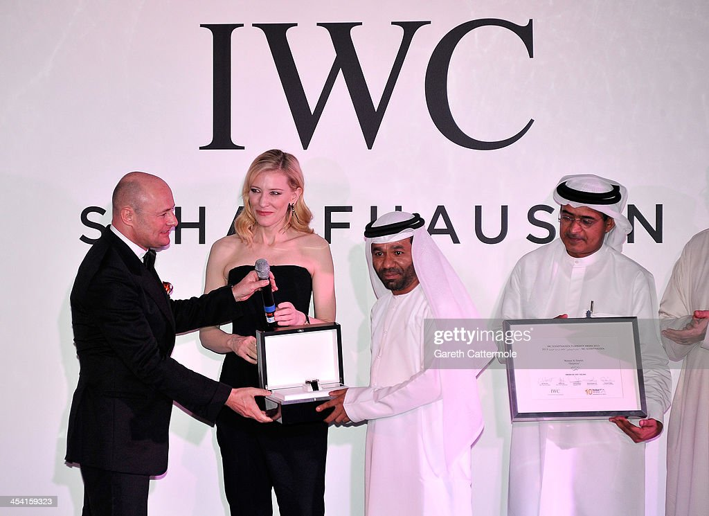 Waleed Al Shehhi is presented with his award by <a gi-track='captionPersonalityLinkClicked' href=/galleries/search?phrase=Georges+Kern&family=editorial&specificpeople=623163 ng-click='$event.stopPropagation()'>Georges Kern</a> (L), <a gi-track='captionPersonalityLinkClicked' href=/galleries/search?phrase=Cate+Blanchett&family=editorial&specificpeople=201621 ng-click='$event.stopPropagation()'>Cate Blanchett</a> and DIFF Chairman Abdulhamid Juma on stage at 'For The Love of Cinema - IWC Filmmakers Award' during day two of the 10th Annual Dubai International Film Festival held at the One and Only Mirage Hotel on December 7, 2013 in Dubai, United Arab Emirates.