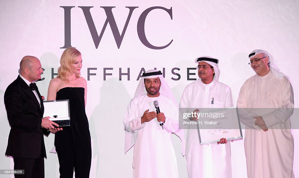 Waleed Al Shehhi speaks as he is presented with his award by <a gi-track='captionPersonalityLinkClicked' href=/galleries/search?phrase=Georges+Kern&family=editorial&specificpeople=623163 ng-click='$event.stopPropagation()'>Georges Kern</a> (L), <a gi-track='captionPersonalityLinkClicked' href=/galleries/search?phrase=Cate+Blanchett&family=editorial&specificpeople=201621 ng-click='$event.stopPropagation()'>Cate Blanchett</a>, DIFF Chairman Abdulhamid Juma and Artistic Director of DIFF Masoud Amralla Al Ali (R) on stage at 'For The Love of Cinema - IWC Filmmakers Award' during day two of the 10th Annual Dubai International Film Festival held at the One and Only Mirage Hotel on December 7, 2013 in Dubai, United Arab Emirates.