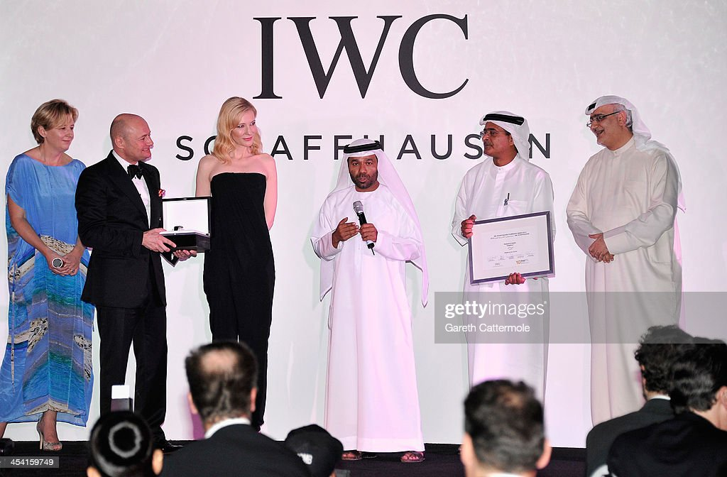 Waleed Al Shehhi speaks as he is presented with his award by <a gi-track='captionPersonalityLinkClicked' href=/galleries/search?phrase=Georges+Kern&family=editorial&specificpeople=623163 ng-click='$event.stopPropagation()'>Georges Kern</a> (second left), <a gi-track='captionPersonalityLinkClicked' href=/galleries/search?phrase=Cate+Blanchett&family=editorial&specificpeople=201621 ng-click='$event.stopPropagation()'>Cate Blanchett</a>, DIFF Chairman Abdulhamid Juma and Artistic Director of DIFF Masoud Amralla Al Ali (R) on stage at 'For The Love of Cinema - IWC Filmmakers Award' during day two of the 10th Annual Dubai International Film Festival held at the One and Only Mirage Hotel on December 7, 2013 in Dubai, United Arab Emirates.