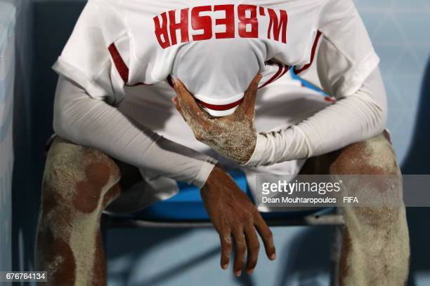 Waleed Beshr of United Arab Emirates looks dejected and hides under his shirt after defeat in the FIFA Beach Soccer World Cup Bahamas 2017 group C...