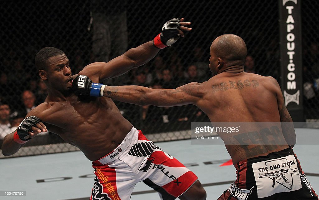 Walel Watson punches Yves Jabouin during the UFC 140 event at Air Canada Centre on December 10, 2011 in Toronto, Ontario, Canada.