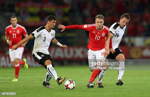 Wales' Aaron Ramsey in action with Austria's Aleksander Dragovic and Julian Baumgartlinger during the 2018 FIFA World Cup Qualifying Group D match at...