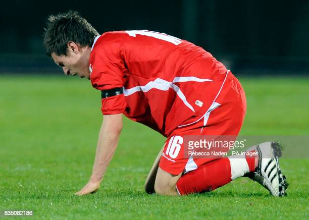 Wales' Aaron Ramsey in pain on the ground