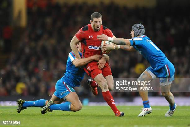 Wales' Alex Cuthbert is tackled by Italy's Mauro Bergamasco and Michele Campagnaro