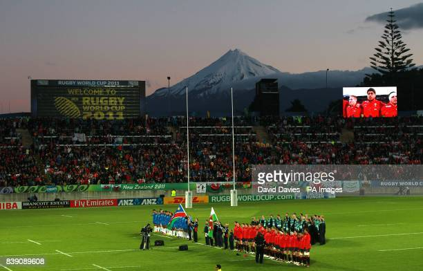 Wales and Namibia players line up for the match under the backdrop of Mount Taranaki