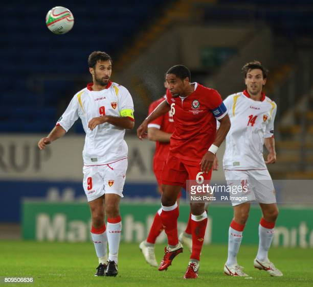Wales' Ashley Williams wins a header from Montenegro pair Mirko Vucinic and Dejan Damjanovic during the European Championship Qualifying match at the...