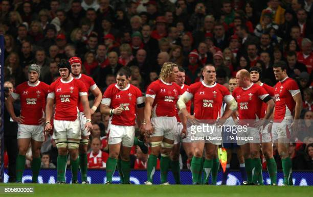 Wales assemble under the posts after conceeding a third try during the Autumn International match at the Millennium Stadium Cardiff