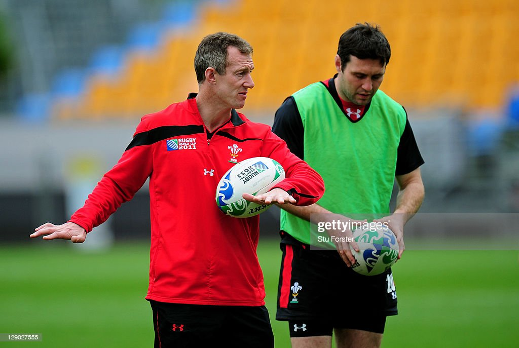 Wales assistant coach Rob Howley (L) speaks with flyhalf Stephen Jones during a Wales IRB Rugby World Cup 2011 training session at Mt Smart Stadium on October 11, 2011 in Auckland, New Zealand.