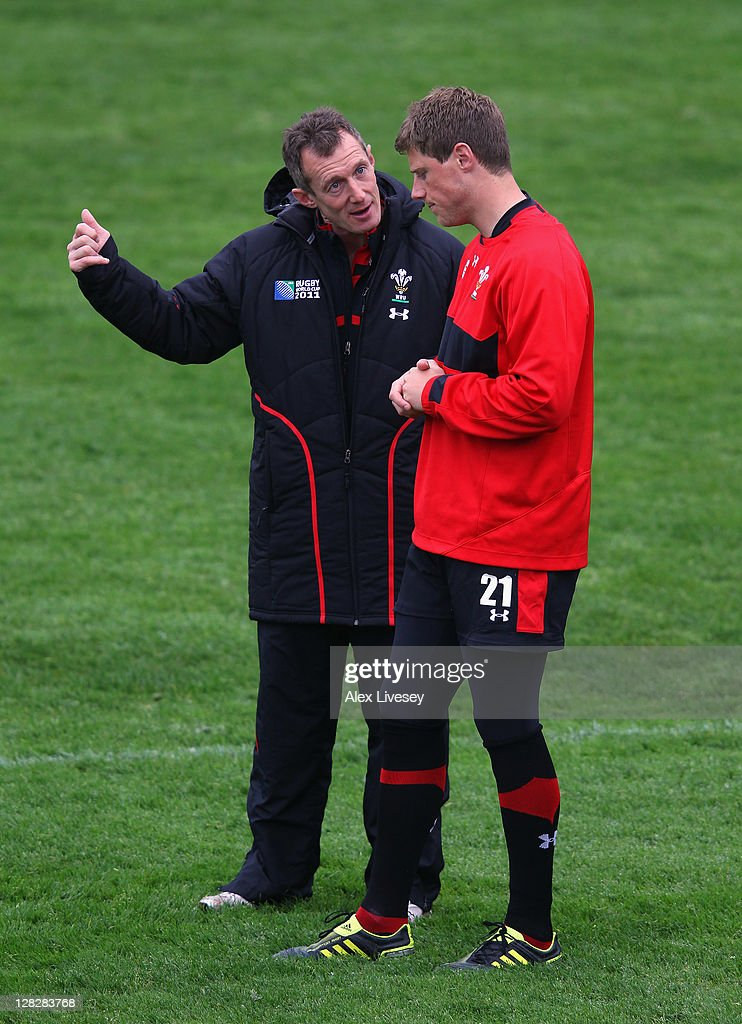 Wales assistant coach Rob Howley (L) talks with Rhys Priestland during a Wales IRB Rugby World Cup 2011 training session at Newtown Park on October 6, 2011 in Wellington, New Zealand.