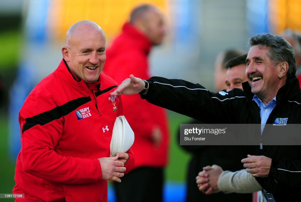 Wales assistant coach <a gi-track='captionPersonalityLinkClicked' href=/galleries/search?phrase=Shaun+Edwards+-+Rugby+Player&family=editorial&specificpeople=15368723 ng-click='$event.stopPropagation()'>Shaun Edwards</a> (L) shares a joke with former Wales and British Lions wing <a gi-track='captionPersonalityLinkClicked' href=/galleries/search?phrase=Gerald+Davies&family=editorial&specificpeople=1625801 ng-click='$event.stopPropagation()'>Gerald Davies</a> (R) during a Wales IRB Rugby World Cup 2011 training session at Mt Smart Stadium on October 13, 2011 in Auckland, New Zealand.