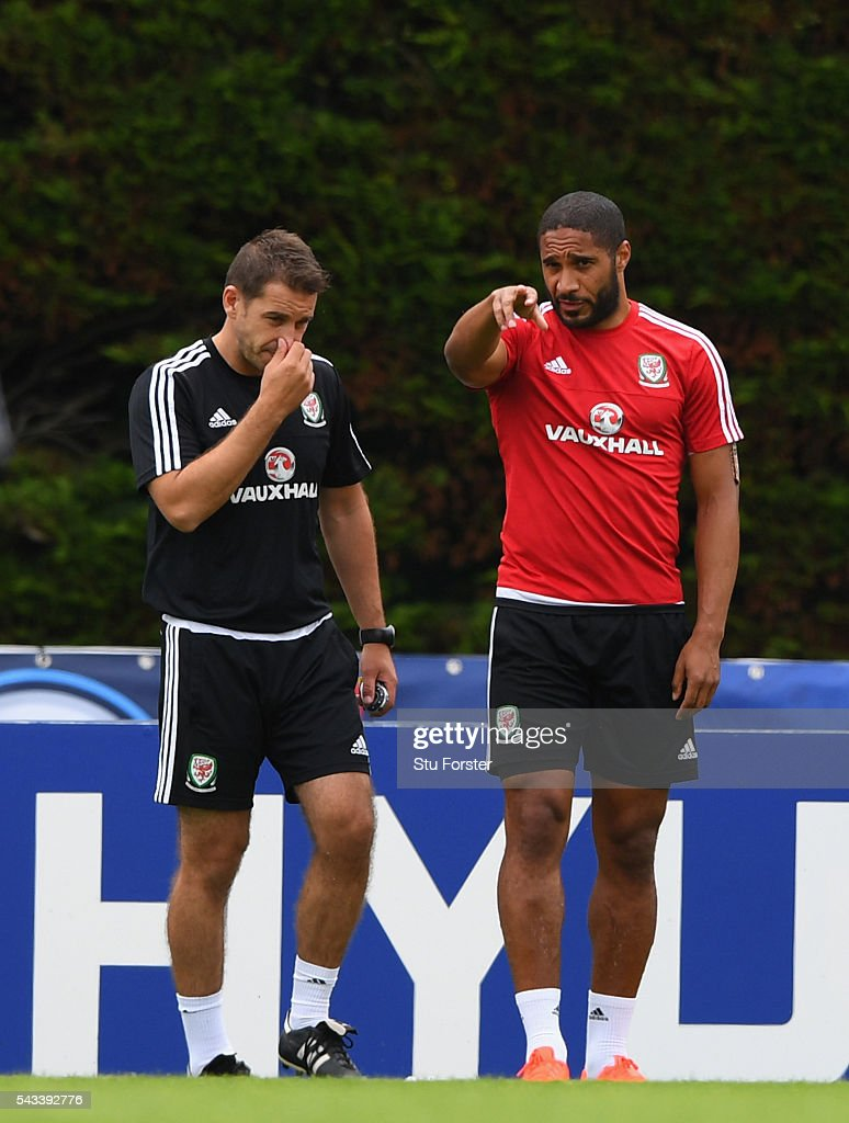 Wales captain <a gi-track='captionPersonalityLinkClicked' href=/galleries/search?phrase=Ashley+Williams+-+Soccer+Player&family=editorial&specificpeople=13495389 ng-click='$event.stopPropagation()'>Ashley Williams</a> chats with Dr Adam Owen during Wales training at their Euro 2016 base camp ahead of their Quarter Final match against Belguim, on June 28, 2016 in Dinard, France.