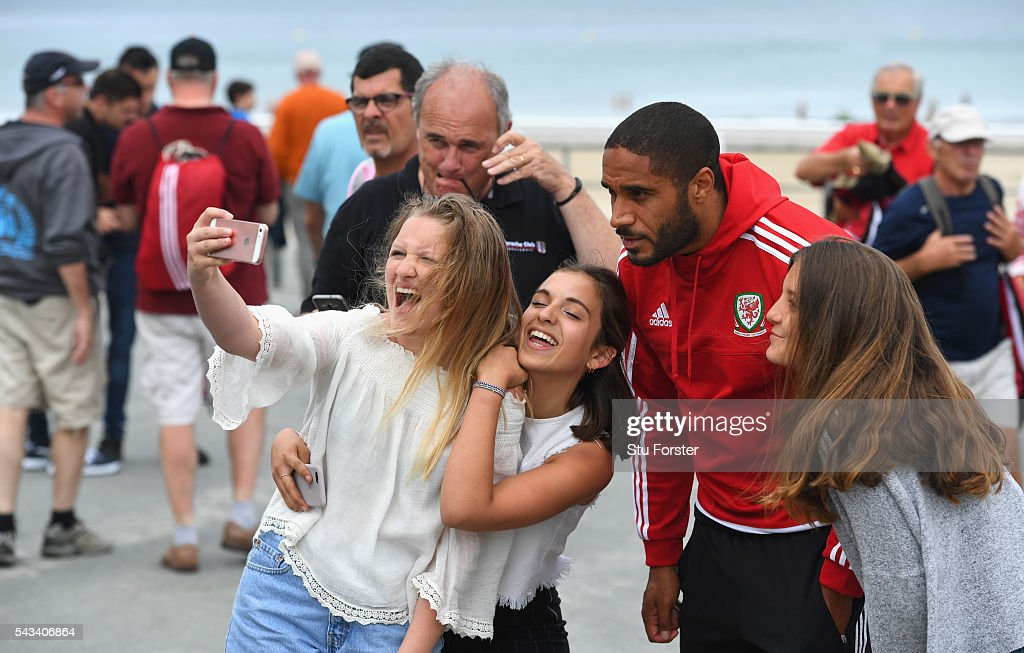 Wales captain <a gi-track='captionPersonalityLinkClicked' href=/galleries/search?phrase=Ashley+Williams+-+Soccer+Player&family=editorial&specificpeople=13495389 ng-click='$event.stopPropagation()'>Ashley Williams</a> poses for a selfie with locals after a stroll around Dinard town on June 28, 2016 in Dinard, France.