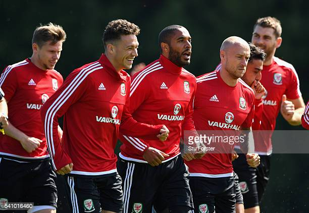 Wales captain Ashley Williams shares a joke with fellow defender James Chester during Wales training at their Euro 2016 basecamp on June 18 2016 in...
